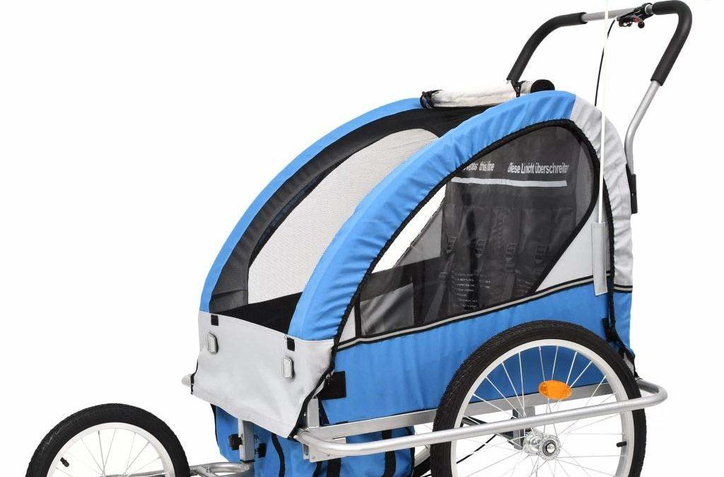 Pour les promenades en vélo en famille : le trailer pour enfant à partir de 9 mois à accrocher au vélo de papa ou de maman