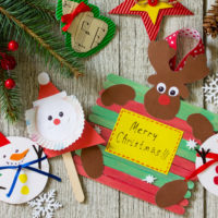 Christmas merry gift on wooden table - Santa, Reindeer and snowman toys. Handmade. Project of children's creativity, handicrafts, crafts for kids.