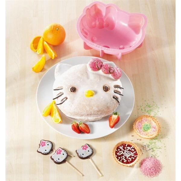 Faire un gâteau hello kitty, decorer facilement un gâteau hello kitty : decor en sucre, disque azyme et confiseries pour decorer pâtisserie avec Hello kitty