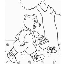 coloriage petit ours brun cherche des oeufs de pâques dans le jardin
