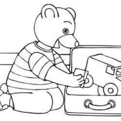 coloriage petit ours brun et ses jouets