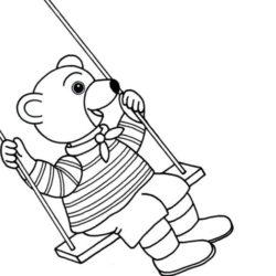 coloriage petit ours brun sur une balançoire au jardin d'enfant
